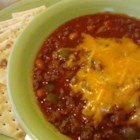 Mighty Matt's Kick-Butt Chili - Ground beef, a tomato base, pinto beans, and a variety of spices are combined to make a fiery hot chili that is perfect for a cold winter's day.  The key to the heat is in the cayenne pepper so adjust to your individual taste.  Double the recipe to make a crowd pleasing addition to your next football watching party.