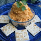 Roasted Red Pepper-Cheese Spread - Roasted red bell peppers and Worcestershire sauce blended with sharp Cheddar cheese and a bit of mayonnaise creates a tasty adaptation of the classic pimento cheese spread.