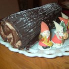 "Classic Yule Log - A chocolate sponge cake is rolled around a whipped cream filling and iced with a rich chocolate frosting ""bark"" in this lovely Christmas dessert."