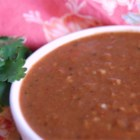 Enchilada Sauce - Onion and garlic are sauteed with cumin, cinnamon and chili powder, then simmered with chicken broth.  Blending in semisweet chocolate is the key to creating this authentic taste of Mexico.
