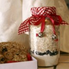 Cookie Mix in a Jar III - Oatmeal Raisin Spice cookie mix in a jar with tag attached with directions on how to prepare the mix. These make wonderful gifts to give any time of year, and also for wedding favors, hostess gifts, baby showers, or take to a cookie exchange. Make sure to bake some up so people know what they taste like. Store in a cool dry place away from a heat source so condensation and clumping does not occur. Enjoy.