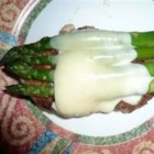 Quick Chicken with Asparagus and Provolone - Breaded chicken, browned, and cooked in chicken broth. Covered with Provolone cheese and canned asparagus.