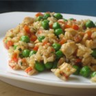 Garlic Chicken Fried Brown Rice - Leftover brown rice is reborn in this chicken fried rice with peppers and onions. Black pepper, paprika, or dried parsley may be used to season after this is cooked.