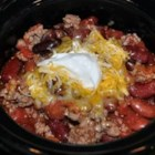 Ten Minute Chipotle Spiced Beef and Bean Chili - Browned ground beef is combined with cans of beans and minced chipotle peppers in adobe sauce in this spicy tomato based chili.  Serve with a dollop of sour cream and grated cheddar cheese.