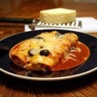 Turkey Enchiladas - Use canned enchilada sauce to reduce the preparation time in these turkey filled corn tortillas with olives, onions and two cheeses.