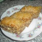 Grecian Baklava - Crispy phyllo layers surround a walnut filling in this sticky sweet Greek treat!