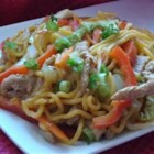 Sweet and Spicy Pork and Napa Cabbage Stir-Fry with Spicy Noodles - Chili sauce lends both sweetness and spiciness to this noodle dish featuring napa cabbage, celery, carrots, and pork.