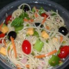 Cold Spaghetti Salad - A zesty pasta salad with pepperoni, mushrooms, green olives, and tomatoes. Ready to eat right away, or even better marinated overnight.