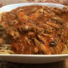 Homemade Chicken Cacciatore, Sicilian-Style - This recipe is made with tomatoes, onions, peppers, wine, and seasonings.