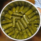 Dolmas (Stuffed Grape Leaves) - Grape leaves are filled with a mixture of rice, onions, currants, pine nuts, mint and spices, and then gently steamed.  Serve chilled, as is traditional, or warm, as desired.   Squeeze fresh lemon juice over dolmas before serving.