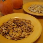 Spicy Roasted Pumpkin Seeds - Roasted pumpkin seeds are seasoned with a hint of spice and garlic in this easy fall recipe.