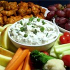 Blue Cheese Dip II - Blue cheese crumbles kindly lend their distinctive flavor to this simple, smooth mixture. Serve with corn chips. This dip tastes better the longer it chills before serving.