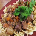 Beef Bourguignon II - Stewing meat is browned and braised in red wine with carrots, garlic,  onions, and herbs. Mushrooms and more onions are added for the last half hour of cooking.
