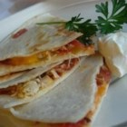 Cheese Quesadillas - Three ingredients are all you need for Luke Walker's Mexican twist on grilled cheese. The Unionville, Ontario teenager says the tasty wedges are ideal as an after-school snack or with soup at lunchtime. Youngsters can easily assemble the quick quesadillas but should get an adult's help popping them under the broiler.