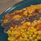 Mexican Meatloaf II - This Mexican-inspired meatloaf is flavored with hot and spicy cheese crackers and topped with Cheddar cheese and chunky salsa.