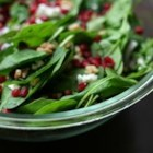 Spinach Pomegranate Salad - This is a simple and beautiful salad made with pomegranate seeds and feta cheese.