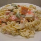 Crab Salad III - This creamy and colorful salad is inexpensive and flavorful.  Seashell macaroni and crab meat are dotted with a delicious blend of herbs, green pepper, olives, radishes, tomato and celery.  If you don't have celery on hand, just substitute some celery seed instead for flavor!