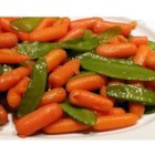 Honey Glazed Pea Pods and Carrots - A touch of golden honey flavors these tender pea pods mixed with sweet carrots.