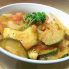 Italian Zucchini Saute - This is just like Nonni used to make! Fresh zucchini, onions, and tomatoes sauteed with Italian seasonings make a perfect complement to any meal. Serve alone or over rice.