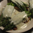 Veal Oscar - Breaded veal cutlets served with crab and asparagus and a cheddar cheese sauce.