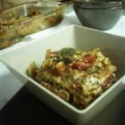 Vegan Lasagna I - A thick tomato-based sauce is cooked up with hints of garlic, onion, parsley, and basil, and layered with a tofu and spinach filling.