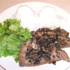 Mahi Mahi with Onions and Mushrooms - Very good and easy mahi mahi filets steamed over yellow onions, button mushrooms and garlic.