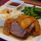 Pork Tenderloin with Apples - Pork tenderloin is cooked to perfection and served with a sauce made of fresh apples and Riesling wine in this simple, yet elegant dish.