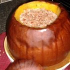 Dinner in a Pumpkin I - Stuff and bake a whole pumpkin with layers of browned ground beef, rice and vegetables in this no-dish meal which serves up to 10 people.