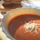 Spicy Tomato Bisque with Grilled Brie Toast - Nothing's more comforting than grilled cheese and tomato soup.  This is a gussied-up version, with grilled Brie cheese sandwiches and spiced tomato bisque with basil.  As the soup soaks into the sandwich, break into pieces with your spoon and ladle up with the soup.