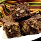 Pumpkin Brownies - Chocolate and pumpkin-nut batters are swirled together to make a decorative, delicious marbled brownie.