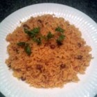Easy Arroz con Gandules - Cilantro and other ingredients are whirred in the blender to create a seasoning base called soffrito used in this Latin rice and pigeon pea  - gandulas  - dish. Tomato sauce and soffrito impart a lovely flavor to the rice that is then cooked with the peas.