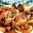 Clams and Chourico - These clams are steamed in dark beer with chourico sausage and red onions for a full flavored meal.