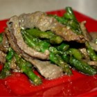 Sesame Beef - Strips of round steak and chopped scallions are marinated with soy sauce and garlic, then quickly stir-fried with sesame seeds. Add a little sesame oil to the marinade if you like that flavor.