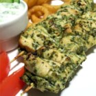Chicken Hariyali Tikka - Chicken breast meat is rubbed with an intoxicating paste made with cilantro, mint, and other distinctive flavors. Chicken legs may also be used, or a combination of legs and breasts. This recipe is cooked in the oven, but will work well on the grill. Serve hot with onion rings.