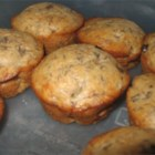 Banana Chip Muffins II - These tasty muffins are low in fat, but downright yummy.  As banana compensates for the texture of fat, no butter, oil or egg yolks are used in this recipe.  Chocolate chips make these muffins extra special.