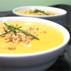 Creamy Sweet Potato With Ginger Soup - Made with sweet potatoes and seasoned with ginger, nutmeg, and cayenne pepper, this creamy soup is topped with honey-roasted peanuts.