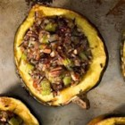 Wild Rice Stuffed Acorn Squash  - Acorn squash are stuffed with a mixture of cornbread, mushrooms, and wild rice flavored with sage to make an impressive vegetarian main course or side dish that's fit for a special occasion or holiday meal.