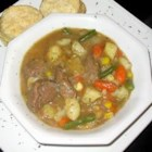 Beef Stew I - Green beans, corn and rice are featured in this beef stew made with carrots and potatoes in a rosemary seasoned broth.