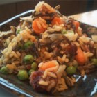 Cashew Raisin Rice Pilaf - This dish includes both long grain and wild rice with vegetables like carrots and peas and the sweet and savory flavors of raisins and cashews.