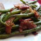 Smothered Green Beans - Fresh green beans with a robust bacon, onion, and garlicky flavor.