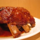 Maple Glazed Ribs - Baby back ribs are basted with a sweet and pungent sauce made from maple syrup, brown sugar, Worcestershire, mustard, ketchup and vinegar.