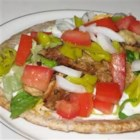 Chicken Souvlaki Gyro Style - An easy and delicious way to recreate your favorite Greek restaurant dish at home. This Mediterranean-flavored recipe can be served buffet-style allowing your guests to make their own.