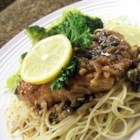 Chicken Piccata with Angel Hair Pasta - This stunning classic piccata made with a tangy and savory lemon and white wine sauce is sure to become a standard in your kitchen!