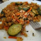 Zucchini Saute - Another pretty dish. Tomatoes, green pepper and zucchini are sauteed until tender and their flavors have mingled. Rice and water are stirred in and everything is cooked until the liquid is absorbed and the rice is fluffy.
