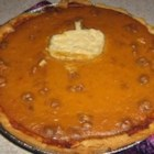 Vanilla Walnut Pumpkin Pie - A smooth and creamy pumpkin pie is made with fresh sugar pumpkin, a premade pie crust, and French vanilla coffee creamer, brown sugar, and a little cinnamon for flavor.