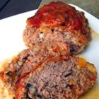 Best Ever Meatloaf II - A combination of ground beef, onion, green pepper, and Cheddar cheese baked in a loaf.