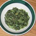 Restaurant-Style Spinach Casserole - This spinach side dish is made on the stove top.  Diced onion is mixed with chopped spinach, butter, seasonings and a can of cream of celery soup and allowed to thicken while stirring over medium heat.