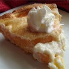 Award Winning Peaches and Cream Pie - This recipe yields a fabulous 10-inch deep-dish pie with an unusual crust made with vanilla pudding, flour, milk, butter, and a bit of baking powder. Sliced peaches are spread over the crust and topped with a fluffy cream cheese layer. It 's then baked and chilled before serving.