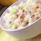 American Lite Fried Rice - An excellent one-dish meal that can easily be improvised to satisfy your tastes or utilized whatever vegetables might be on hand. Jasmine rice lays the foundation for an array of fresh vegetables all tossed with soy sauce to finish. This recipe is vegetarian, but you can easily add your favorite meat, fish, or tofu.