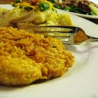 Famous Butter Chicken - Chicken breasts are dipped in beaten eggs and cracker crumbs, then baked with butter. These chicken breast are really tender and moist. Excellent flavor! I never have leftovers.